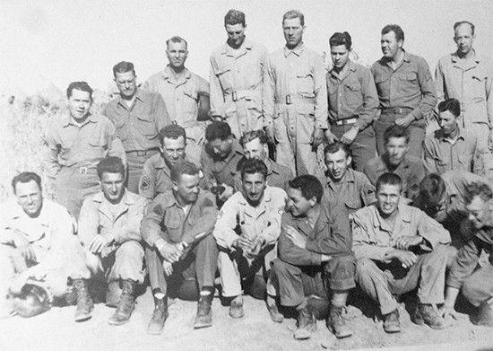Group photograph showing Enlisted personnel of the 11th Evacuation Hospital. The photograph was likely taken during the unit's time in North Africa.Photo courtesy of David Lawrence.