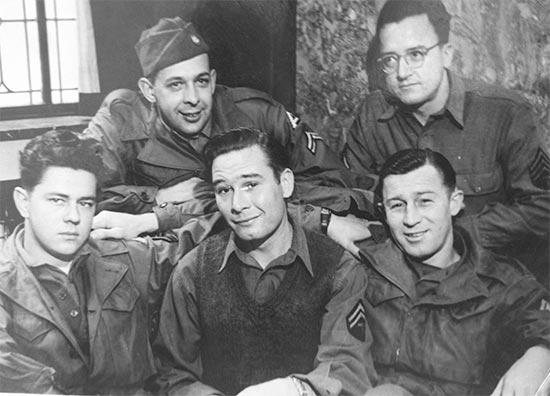 Photograph showing NCOs and Enlisted Men of the 11th Evac Hosp.  First row, left to right: Cpl. Milo S. Moe, T/5 Gene Mayer, T/Sgt R. V. Krause. Back Row, left to right: Cpl. Jerome J.Lawrence and Sgt. Russell Jenning.