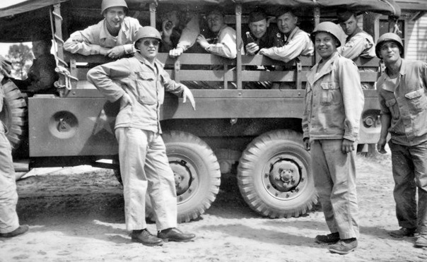 Personnel of the 48th Field Hospital in training. The vehicle illustrated is a 1 1/2-Ton , 6 X 6, Truck, Cargo & Personnel Carrier, manufactured by the Dodge Brothers Corporation (a Division of Chrysler Corporation).