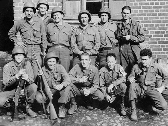 Photograph showing Pvt Richard T. Wright (kneeling, second from left) of the 48th Field Hospital, who later transferred to the 35th Infantry Division, where he served as a Browning Automatic Rifle Assistant Gunner.Photograph, courtesy of Donald L. Wright.