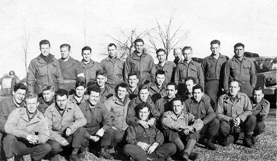 Pvt. Richard T. Wright (last man kneeling, right) and other personnel of the 48th Field Hospital.Photograph, courtesy of Donald L. Wright.
