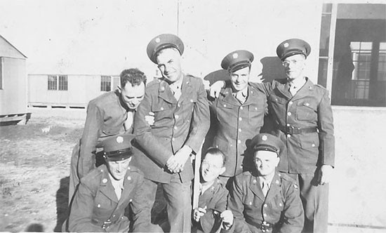 A group of unidentified Enlisted Men of the 30th Evacuation Hospital pose for the camera in front of their barracks building at Camp Barkeley, Texas. Photograph taken during the early phases of the unit's training program in the Zone of Interior.