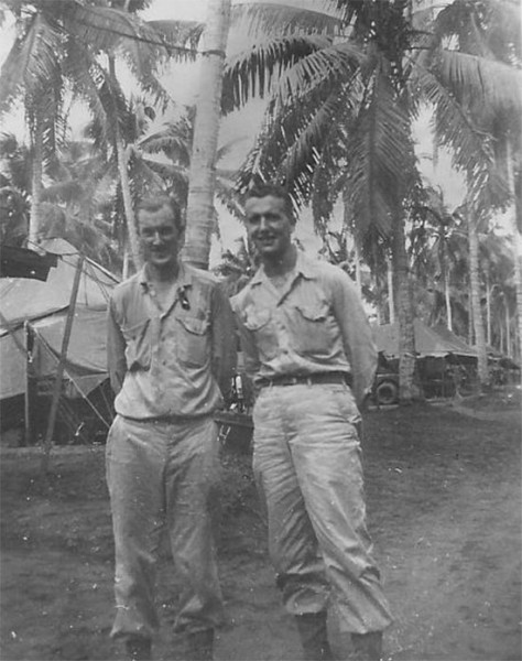 Two unidentified members of the 30th Evac Hosp pictured in front of the unit's tentage on the Philippines.