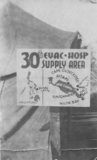 30th Evacuation Hospital Supply Area signpost. Photograph taken during the unit's time in the Philippines.