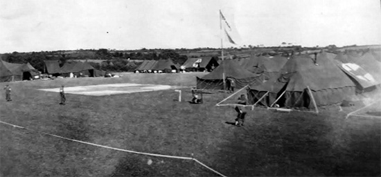 Partial view of 107th Evacuation Hospital bivouac. Photo of tentage probably taken somewhere in the field during the No. 8 Tennessee Maneuvers.