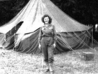 Photo of 1st Lieutenant Ruth M. Haddick, serving with the 2d Hospitalization Unit, 51st Field Hospital in front of a M-1934 Pyramidal Tent.