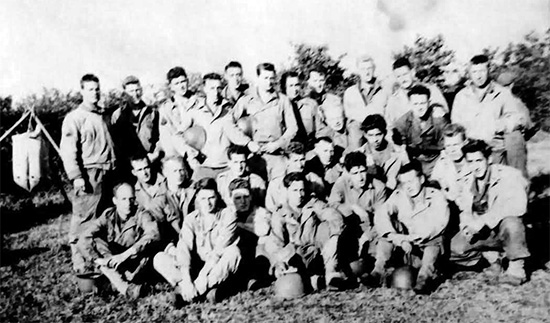 Picture illustrating a group of Noncoms of the 107th Evacuation Hospital. Taken during fall of 1944, in the European Theater, either in Luxembourg or in Belgium.
