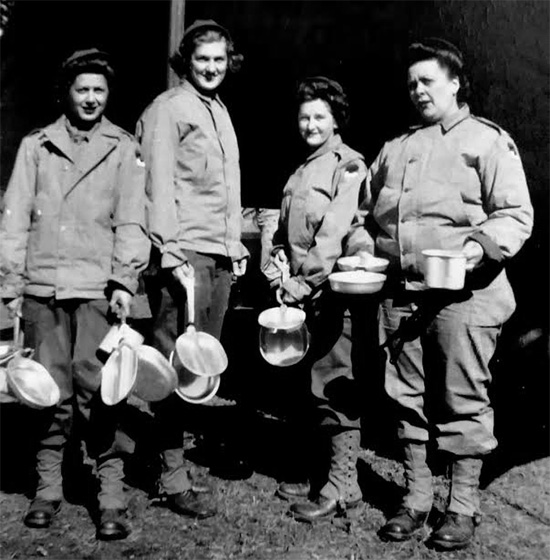 Picture illustrating four Nurses of the 107th Evacuation Hospital. Taken in the Zone of Interior, the ANC Officers are still wearing the SSI of the Second United States Army. Time for chow?