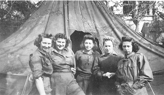 Group of Nurses in front of a M-1934 Fire-Resistant Pyramidal Tent. Maximum capacity of such a tent was 8 people when the pot-bellied stove was not in use. However for reasons of comfort and sanitation, it was recommended to limit the number of persons to 6 when supply of tentage was sufficient.