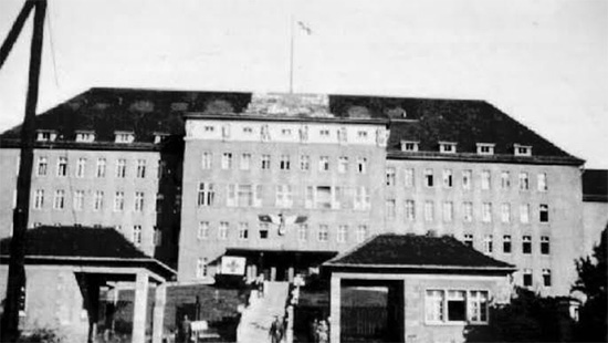 Picture illustrating the former German hospital buildings in Würzburg, Germany, now occupoied by the 107th Evacuation Hospital starting 21 May 1945.