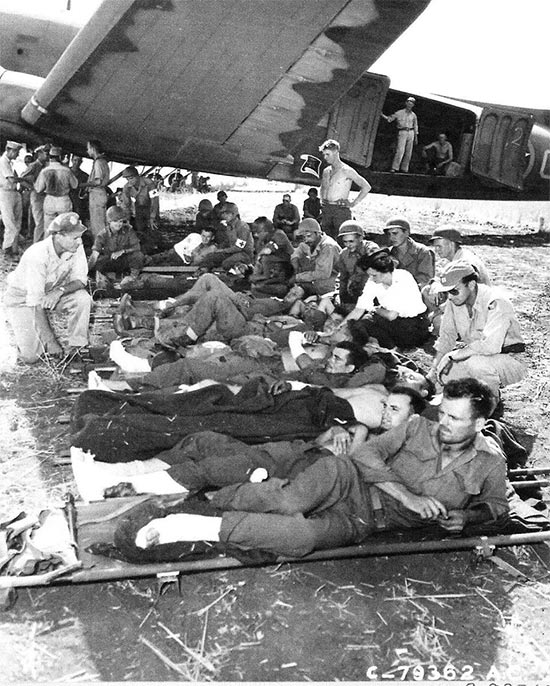 Vintage photo illustrating Allied litter patients waiting to board an evacuation plane that will take them to North Africa. Photo taken at the Agrigento airfield, Sicily, 25 July 1943. The first air evacuation flights left on 23 July. As the campaign moved, additional flights were organized departing from Castelvetrano, Palermo, and Termini.