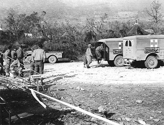 Vintage photo illustrating patients coming in by 3/4-ton ambulance. Photo taken in the vicinity of Venafro, Italy, February 1944, where Unit I, 11th Field Hospital, was set up.