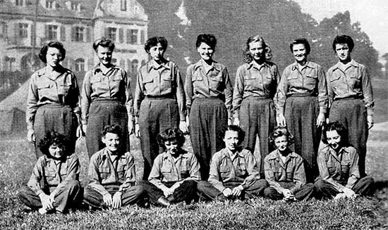 Photograph illustrating some ANC Officers of the 34th Evacuation Hospital Surgical Section. Back Row, from L to R: Lieutenants Harriet G. Markle; Harriet J. Ives; Rose E. Grinberg; Pauline E. Kruzik; Delphine J. Pasinski; Ethel M. Peters, Esther R. McCarthy. Front Row, from L to R: Iris J. Ezzell; Sally T. Watson; Nedra E. Schwartz; Helen A. Surface,Marjorie Chalkley; Laird Sullivan.