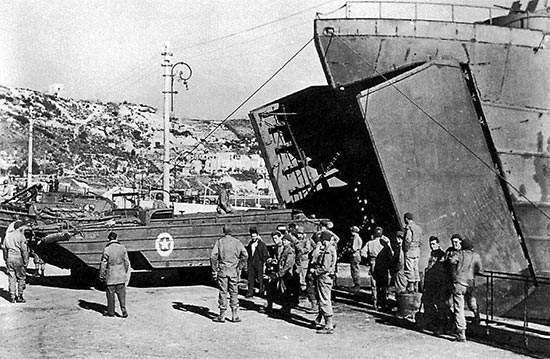 Vintage photo illustrating DUKWs (2 1/2-ton amphibious trucks) leaving an  LST. Photo taken at the Port of Naples, Italy, July 1944.