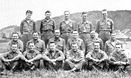 Photograph illustrating Enlisted Men of the 34th Evacuation Hospital Operating Section. Third Row, from L to R: John H. Hirtle; Willis E. Delker; George Lansdale; Harley  M. Johnson; John G. Coffland. Second Row, from L to R: Mirko Magulac; Eugene R. Fisher; Ira J. Glockner; Phillip K. Honeycutt; Mark M. Peterson; William H. Bass. First Row, from L to R: William W. Watford; Kash C. Williams; Frank L. Everly; Stephen M. Velkoff, Herbert Gold; Roy A. Wright.