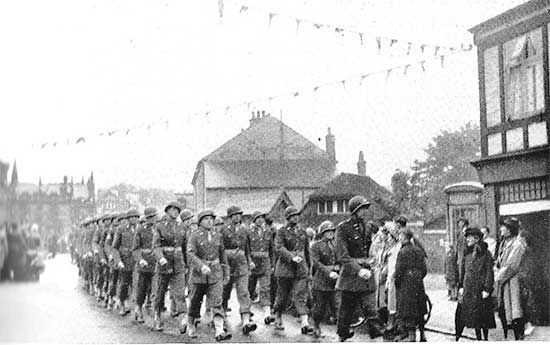 """Personnel of the 34th Evacuation Hospital parading during the """"Salute the Soldier Week"""" in Cheshire County, England."""