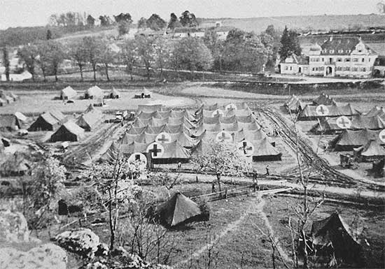 Partial aerial view of the 34th Evacuation Hospital installations (under tentage) at Sandersdorf, Germany. This was to become the unit's last setup until the end of the war and the organization's last stay in the European Theater. The unit remained at Sandersdorf from 28 April to 12 May 1945, where it celebrated V-E Day as well as Memorial Day services.