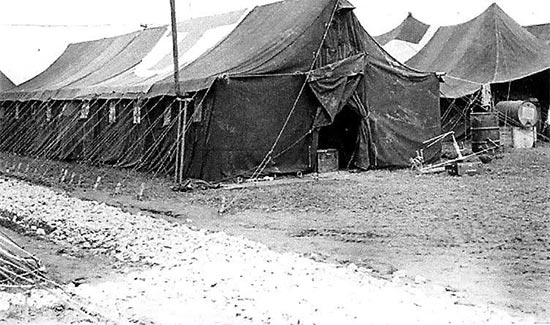 Vintage photo illustrating a typical Sectional Hospital Tent. The tent's dimensions were 54 feet in length, 18 feet in width, and 12 feet in height, and the canvas was made of fire and mildew-resistant material.