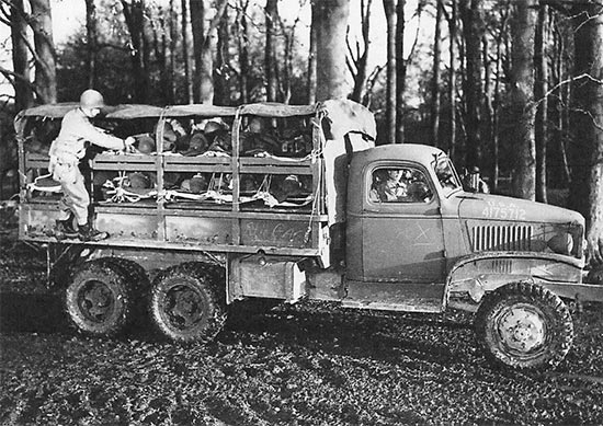 Photo illustrating another way of transporting patients to a Receiving Station, not by a 3/4-ton ambulance, but by the ubiquitous 2 1/2-ton truck.