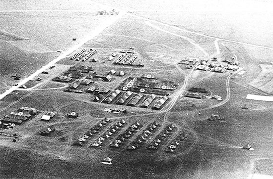 End May 1945, aerial view taken from a liaison aircraft of the 56th Evacuation setup at Udine, north of Trieste, Italy, where the organization would receive its very last patient. The 16th Evacuation Hospital relieved the 56th at Udine on August 4, 1945.