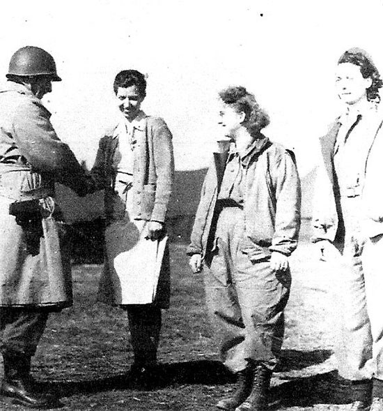February 21, 1944, picture illustrating the award ceremony during which Major General John P. Lucas, CG, VI Corps, awarded 3 Silver Stars to Nurses, with the first citation honoring a 56th Evacuation Hospital ANC Officer, First Lieutenant Mary L. Roberts, ANC (pictured on the left).
