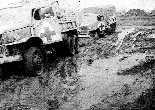 November 1943, trucks of the 56th Evacuation Hospital stuck in the mud in the area around Dragoni, Italy.
