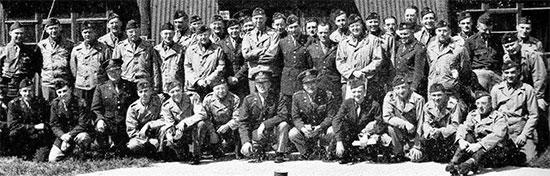 Group picture illustrating 58th General Hospital Officers in front of the Headquarters building at Stowell Park, Gloucestershire, England, some time following the unit's arrival and where they would remain until May 12, 1944.