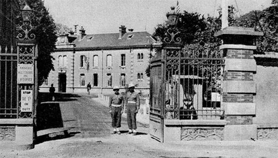 Picture showing the main entrance to the 58th General Hospital, at Châlons-sur-Marne, in Northern France. This would be the Hospital's last operational setup in France. The organization occupied the former French Military Hospital buildings from July 12, 1945 until September 15, 1945.