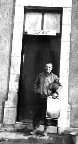 Picture illustrating Major Thomas G. Ferguson, Surgical Division, in front of the building housing Surgery. Picture probably taken at Commercy, France, October 1944.