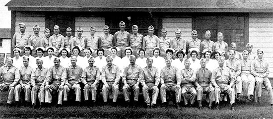 July 1942. Group picture illustrating Officers and Nurses of the 56th Evacuation Hospital prior to departure for the 1942 Louisiana Maneuvers. On July 23, 1942, the organization received its marching orders for Mansfield, Louisiana, from where they moved on to Fort Jessup, Louisiana (a deserted CCC camp), in order to set up a hospital in the area. The men were back at Fort Sam Houston, by 11 November 1942.