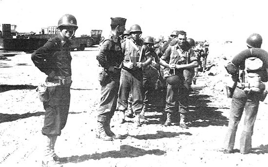 Picture illustrating personnel of the 56th Evacuation Hospital having just landed at Paestum, Italy, September 26, 1943.