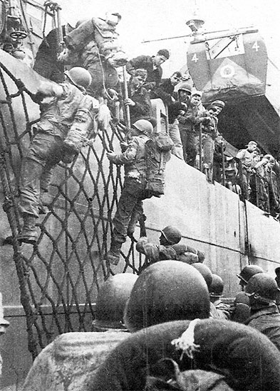 April 9, 1944, Enlisted personnel of the 56th Evacuation Hospital transfer to an offshore LST from an LCT which they initially boarded at Anzio harbor.