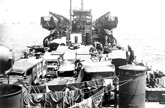 Picture taken aboard LST # 504 enroute to France. The vessel carried the vehicles and drivers of the 58th General Hospital to Utah Beach, Normandy, where debarkation took place July 30, 1944.
