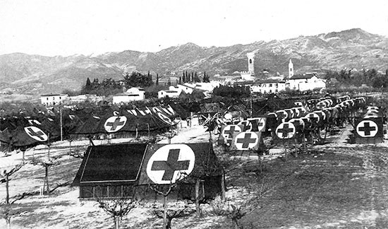 Partial view of the 56th Evacuation Hospital located in a grape orchard, a little south of Scarperia, Italy, where the organization would celebrate Thanksgiving and spend the coming winter. The Hospital's Commanding Officer, Colonel Henry S. Blessé, was to leave the unit during its stay at Scarperia, after receiving orders to return to the Zone of interior on March 4, 1945.