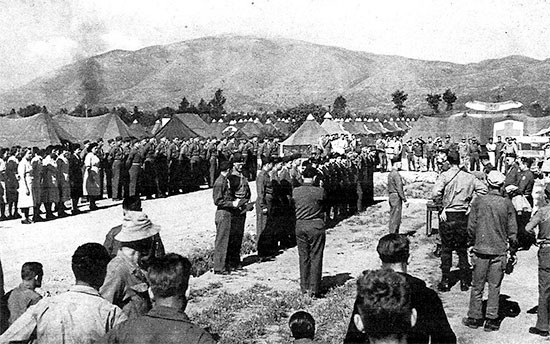 May 15, 1944. Formal review and formation of the 56th Evacuation Hospital attended by Lieutenant General Mark W. Clark who presented 18 Bronze Star Medals to staff and personnel for heroic achievements at Anzio, Italy.