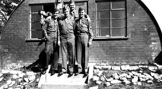 Picture illustrating unidentified personnel in front of their Quonset hut at Stowell Park, England.