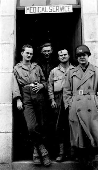 Picture showing Captain John J. Stubbs and some of his Medical Division crew in France. Picture probably taken while stationed in Commercy, France, October 1944.