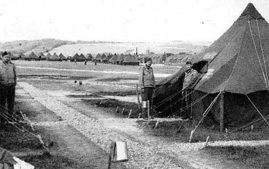 Partial view of endless rows of Quonset huts and canvas pyramidal tents at Parkhouse B, Salisbury Plain Training Area, Wiltshire, England. Picture taken during the latter part of July 1944, prior to the 58th General Hospital's departure to its final marshalling and staging area for further movement to France and the continent.