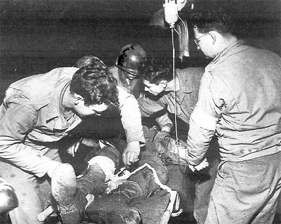 Treating the wounded on Anzio Beachhead, 56th Evacuation Hospital personnel are taking care of a patient.