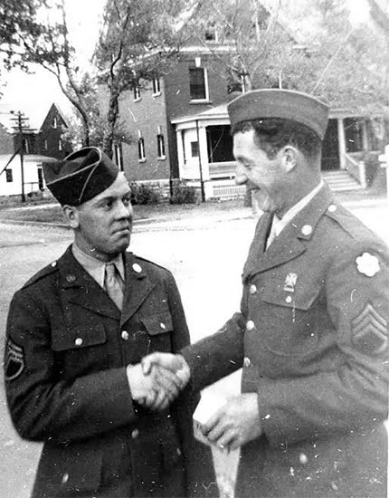 Photograph illustrating Staff Sergeants Eugene Gimbel and Albert Pauly at Fort Francis E. Warren, Cheyenne, Wyoming. Photo taken prior to the unit's oversea movement, end 1943, early 1944.